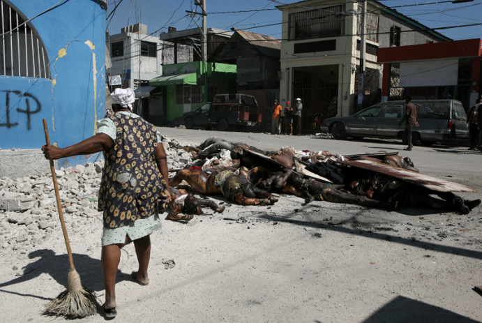 woman sweeping, Haiti