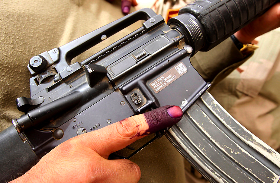 Iraqi security inked finger, gun