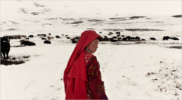 Afghan woman, August snow