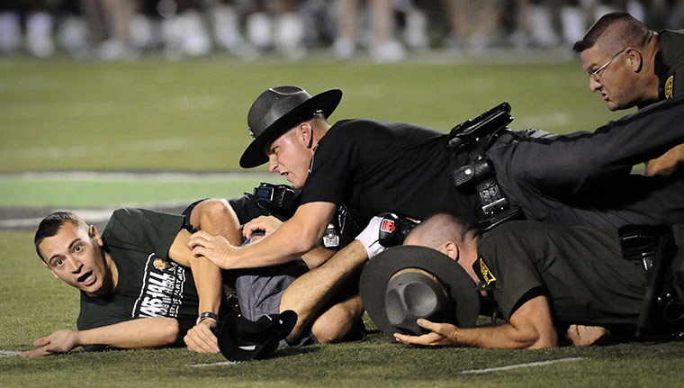 cops on football field takedown