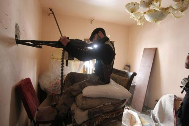 Syrian rebel fighter in house