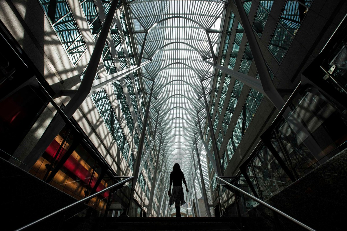 A woman walks through Brookfield Place off Bay Street, on the day of their annual general meeting for shareholders in Toronto