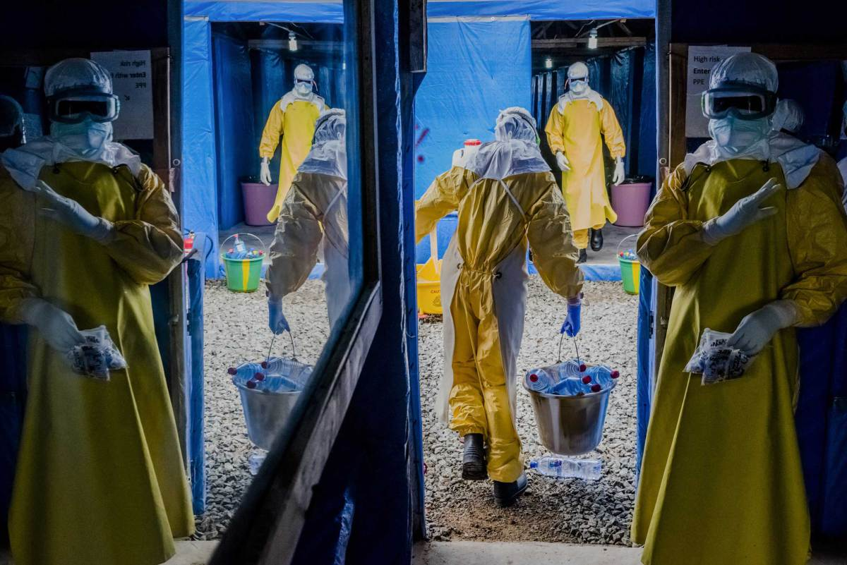 Health workers enter the high-risk zone as they make the morning rounds at the Bong County Ebola Treatment Unit, in Sgt. Kollie Town near Gbarnga.