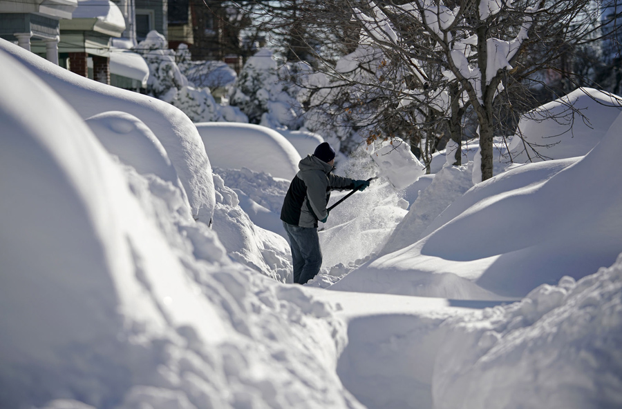 A resident shovels snow away from the entrance to his home in Union City, New Jersey, across the Hudson River from Midtown Manhattan, after the second-biggest winter storm in New York history, January 24, 2016. REUTERS/Rickey Rogers TPX IMAGES OF THE DAY - RTX23SDE