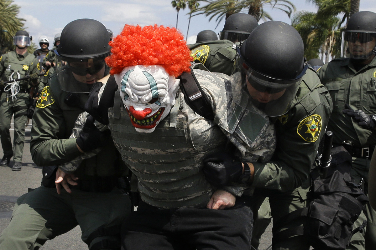 Orange County Sheriff's deputies take a protester into custody near the Anaheim Convention Center Wednesday, May 25, 2016, in Anaheim, Calif., after Republican presidential candidate Donald Trump held a rally at the convention center. (AP Photo/Jae C. Hong)