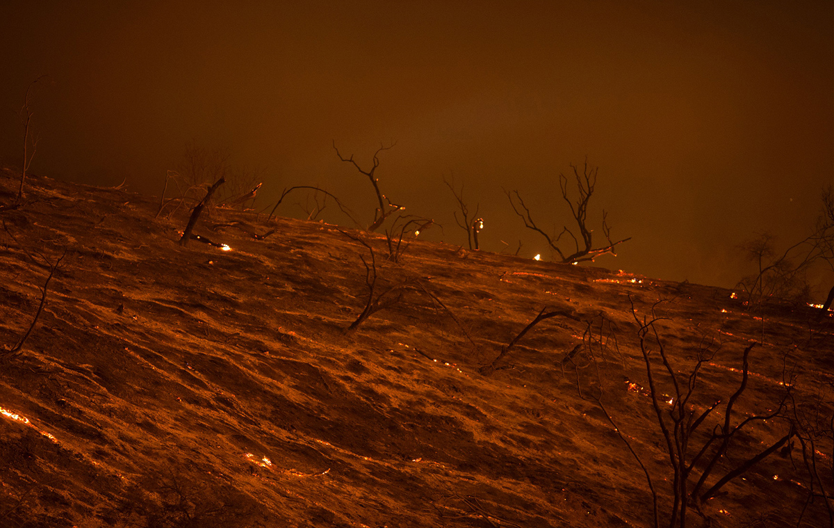 "A freshly scorched landscape is seen in the early morning hours of June 18, 2016 at the Sherpa Fire near Santa Barbara, California. A fire in the Los Padres National Forest had expanded to two square miles (five square kilometers) by Thursday, making it the ""largest since 2009"" in the area, a spokesman for the Santa Barbara County Information Center told AFP. / AFP / DAVID MCNEW (Photo credit should read DAVID MCNEW/AFP/Getty Images)"